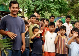 Volunteer with orphans